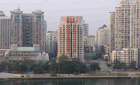 Liuzhou-demolizione-grattacieli-torri-cina-01