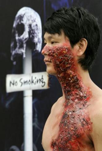 campagna-contro-il-fumo-body-painting-corea-seul-danni