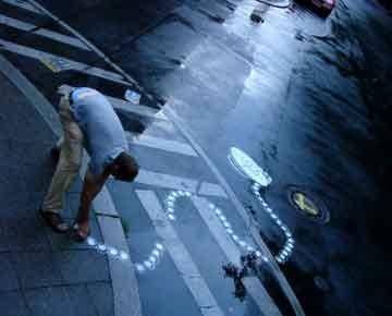 alan-street-art-segnaletica stradale-arte-figurativa-peter-gibson.jpg
