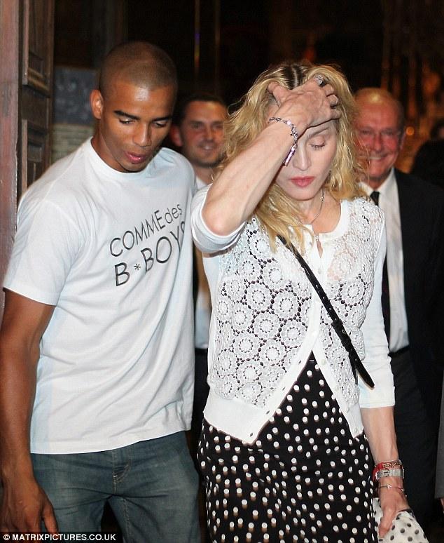 Madonna, denti, diamanti